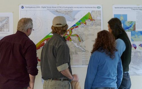 Looking at Hydropalooza maps during a Council meeting in 2009