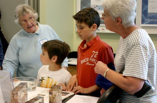 Volunteer Martha Briscoe assists with a Discovery Lab